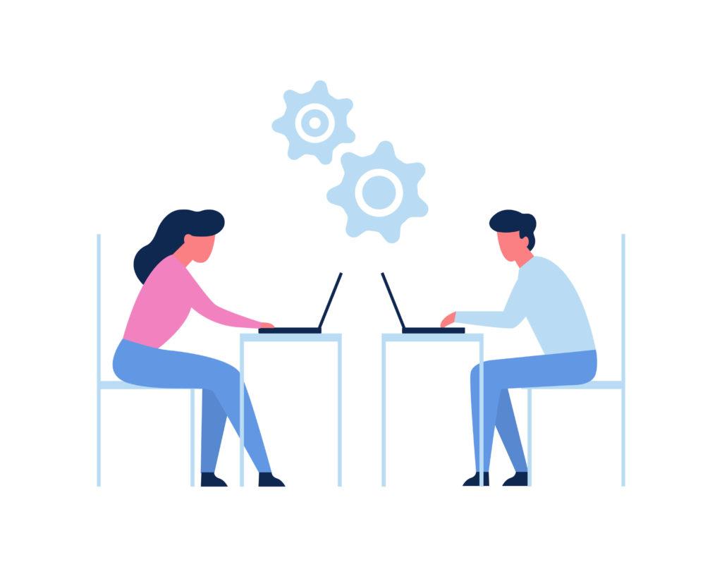 パソコンと向き合う男女