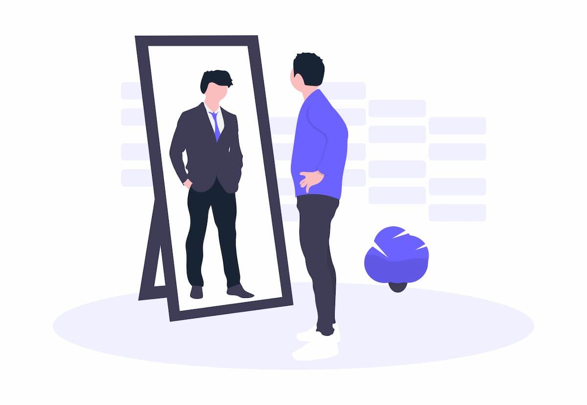 私服の男性と鏡に映ったスーツの男性